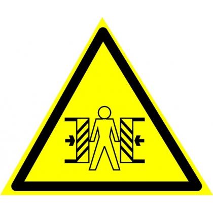 Знак предупреждающий W23 Осторожно, опасность зажима.